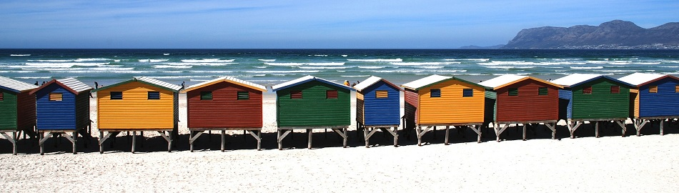 beach-huts-sand_950x270
